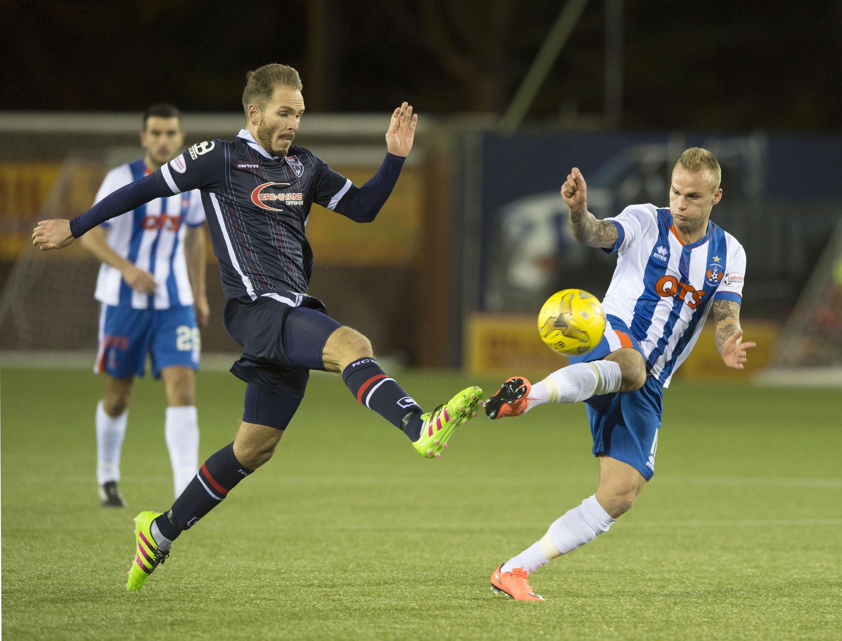 Ross County's Martin Woods (left) battles for the ball against Kilmarnock's Kallum Higginbotham