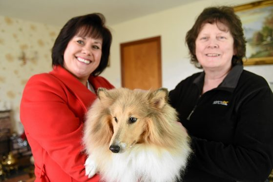 Iona Nicol of Munlochy Animal Aid (right) with 'Callie' while on the left is owner Karen Law.