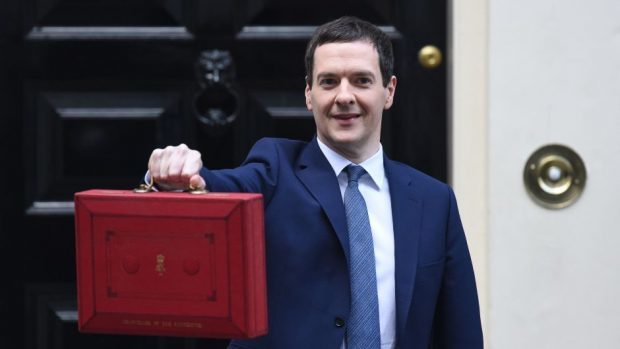 Chancellor of the Exchequer George Osborne outside 11 Downing Street, London, before heading to the House of Commons to deliver yesterday's Budget