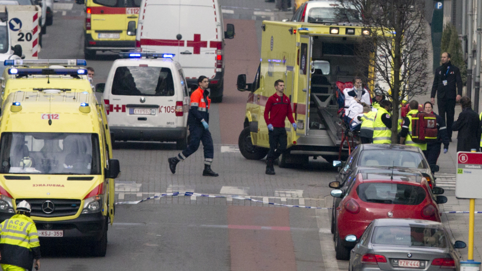 A woman is evacuated in an ambulance by emergency services after a explosion in a main metro station in Brussels (AP)