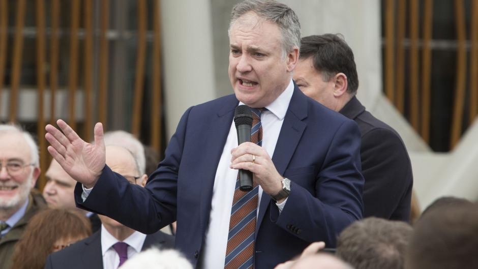 Rural Affairs Secretary Richard Lochhead addresses an NFU Scotland protest rally outside the Scottish Parliament