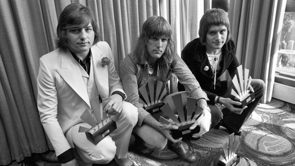 Greg Lake, Keith Emerson and Carl Palmer at Kennington Oval in 1972 with their awards gained in the Melody Maker Polls