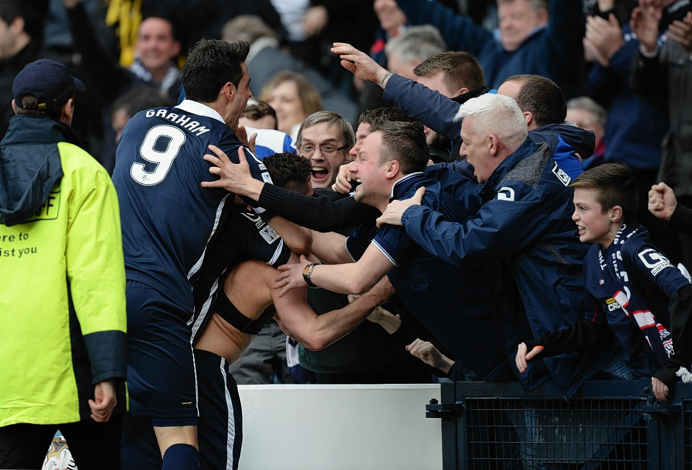 Ross County's Alex Schalk celebrates his winning strike with Staggies fans and team mates