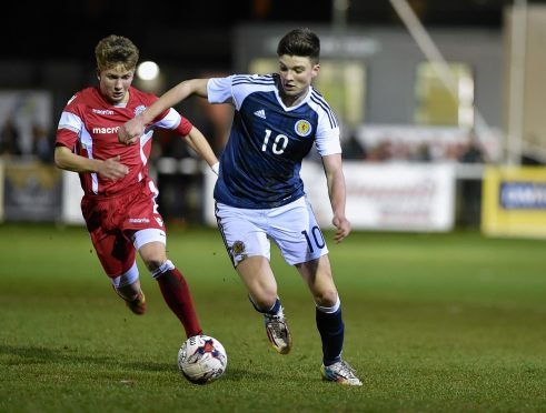 Scotland youngster Mark Smith and Wales' Kyle Jones. Picture by Colin Rennie