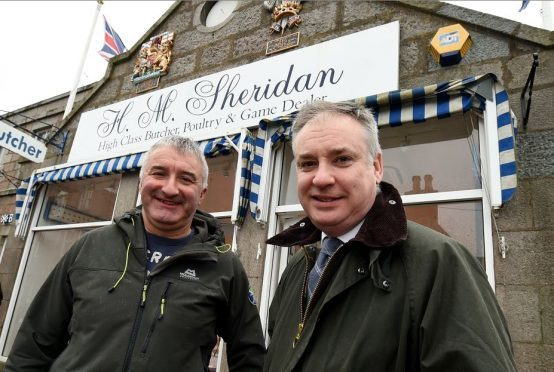 John Sinclair, of Sheridan butchers, Ballater, with Richard Lochhead yesterday.  Credit: Jim Irvine.