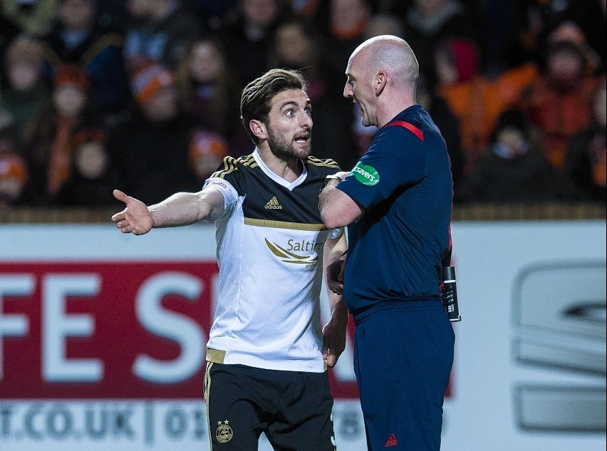 Aberdeen's Graeme Shinnie (left) appeals to referee Bobby Madden after being booked