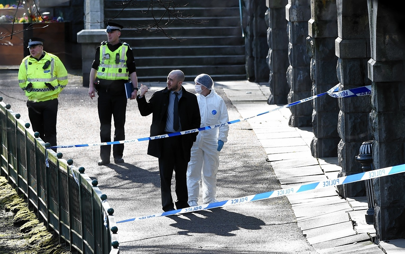 Police investigating the scene of the sex attack in Union Terrace Gardens last year.
