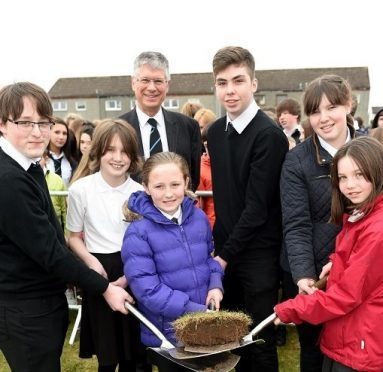 Andy Simpson, head teacher at Elgin High School, with current and future  pupils at the turf-cutting ceremony (Picture: Gordon Lennox)