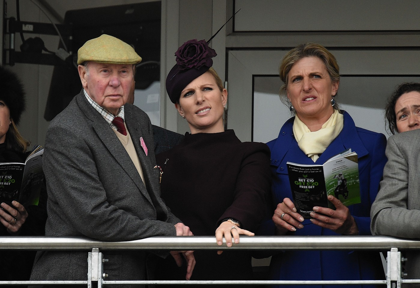 Zara Phillips alongside Owner Trevor Hemmings and Sophie, Countess of Wessex watch the action at Cheltenham