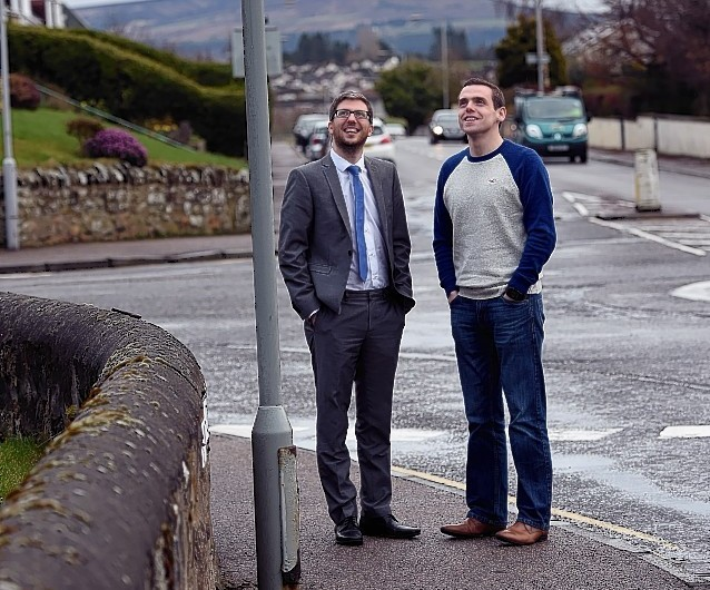 Councillors Gary Coull, left, and Douglas Ross, right, in Wittet Drive, Elgin after the council vote