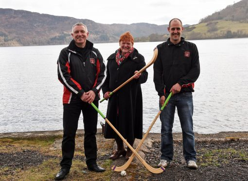 Cllr Margaret Davidson (centre) with Billy MacLean (left) and Lewis MacLennan of Glenurquhart Shinty Club. Picture by Phil Dwnie