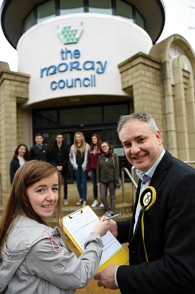 Richard Lochhead with youngster  Caitlin Croft. Picture by Gordon Lennox