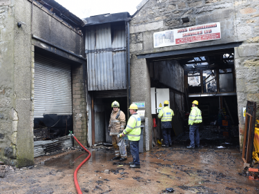 A sawmill, photography studio and repair workshop have been damaged