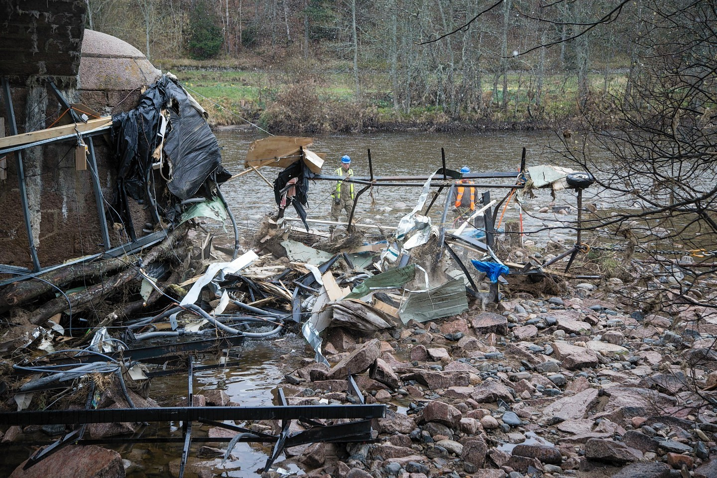 Troops got to work removing debris from the arches of Ballater's Royal Bridge