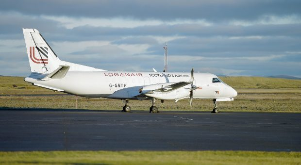 Loganair plane landing at Sumburgh Airport