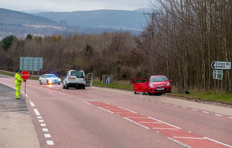 A pensioner is in a life-threatening condition following a two-car smash on the A9. (Picture: Brian Smith)