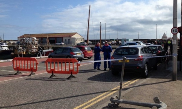 Police at Arbroath Harbour after the discovery of the body. Picture courtesy of The Courier