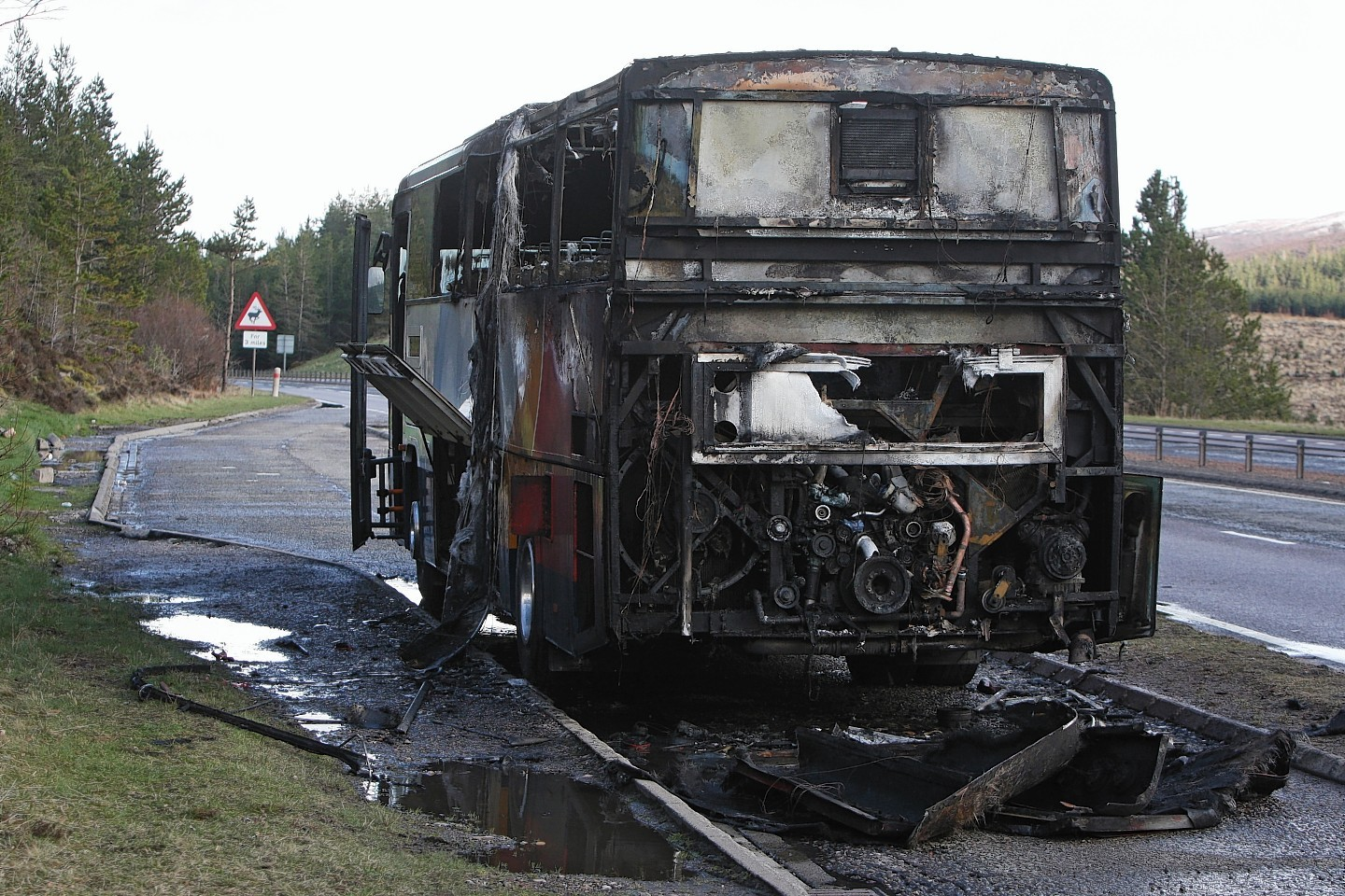 The bus sitting by the side of the A9