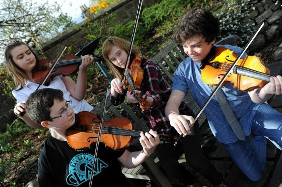 Mark Green, Connie Sim, Amber Thornley, and Andrew Legge play during last year's festival