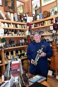 John Mackintosh with some of the memorabilia which forms his Whisky Museum in Forres. Picture by Gordon Lennox