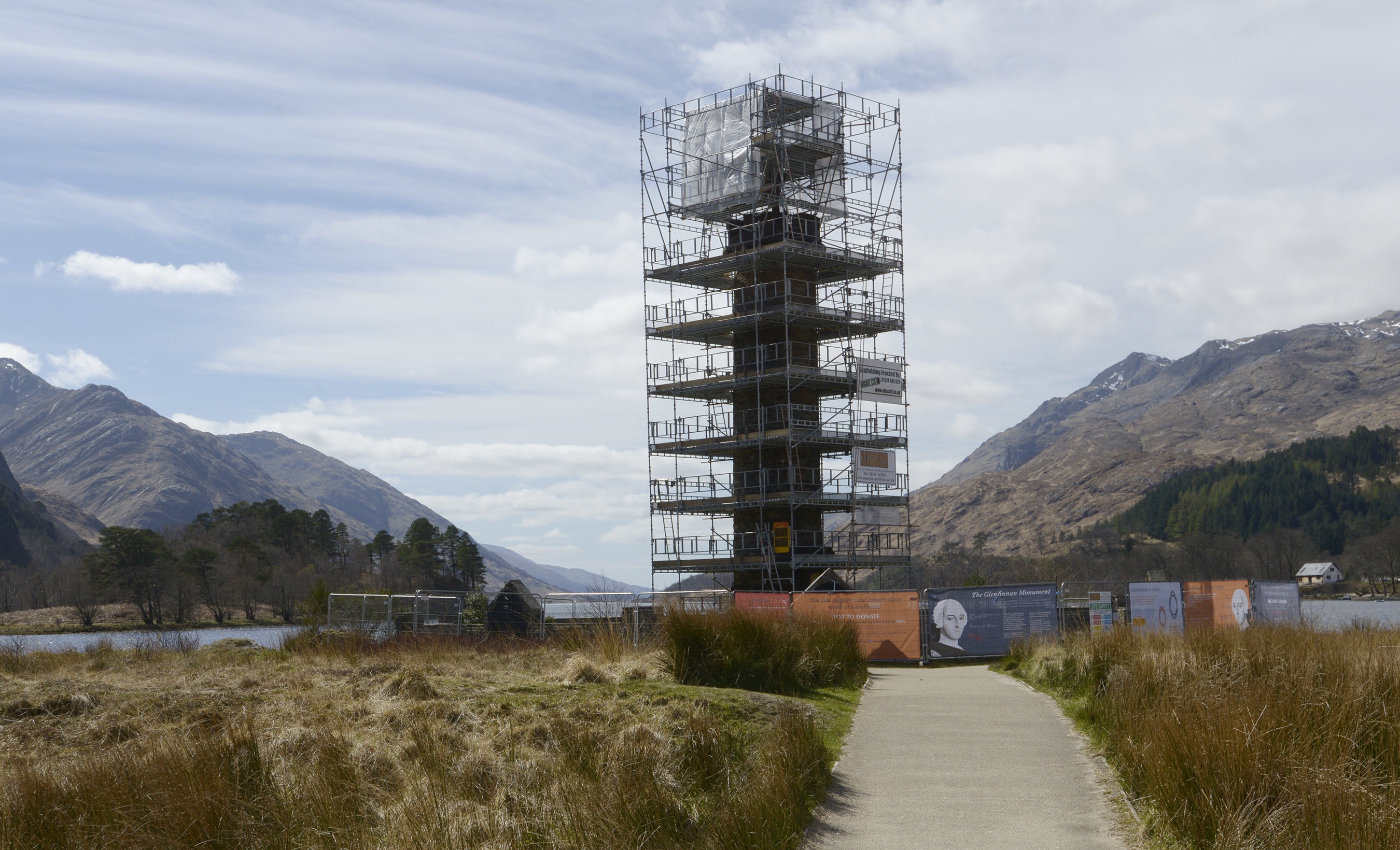 The historic Glenfinnan Monument shrouded in scaffolding during its refurbishment