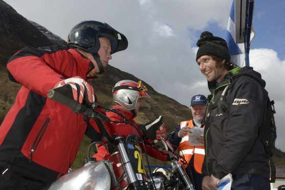 PRE 65 TRIALS 29/4/16 TV presenter,  TT Motorcyclist and Multi word speed records holder, Guy Martin shares a few words with Pre-65's competitor, Tim Blackmore at the start of the event. PICTURE IAIN FERGUSON, THE WRITE IMAGE