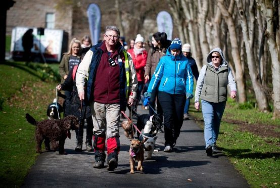 Dog walkers take to Haddo House and Country Park in aid of charity