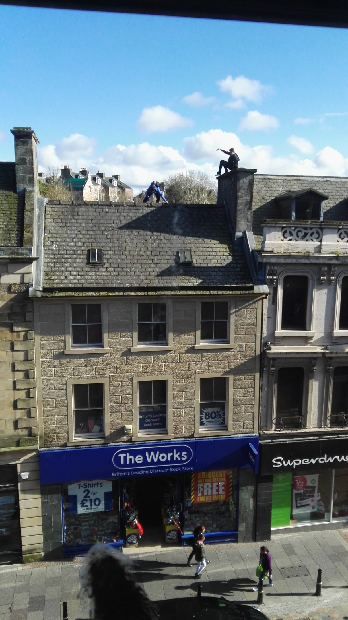 Children playing on rooftops in Inverness city centre