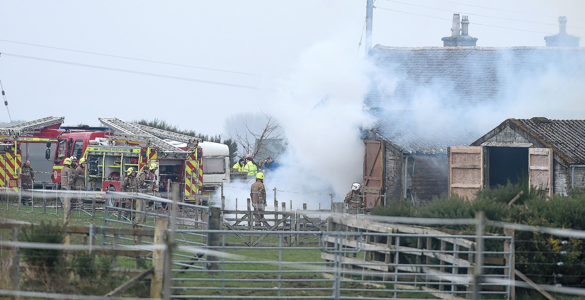 Firefighters at the scene of the blaze at a farm near Invergordon