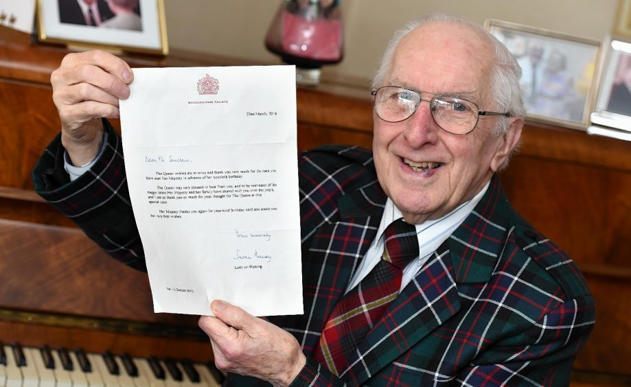 Jack Sinclair with his letter from Buckingham Palace. Picture by Kevin Emslie