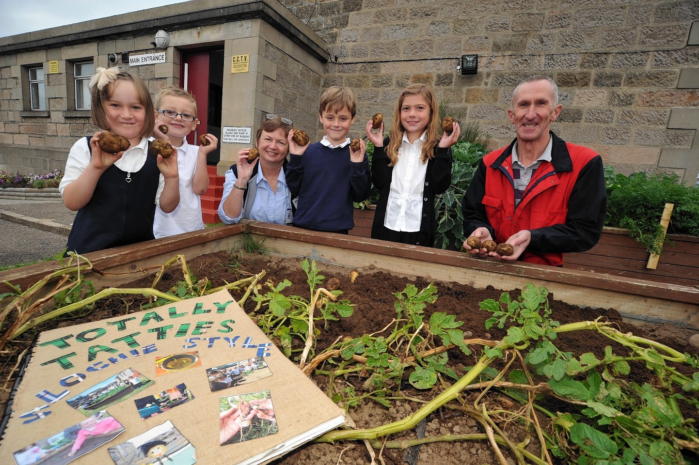 Jim Taylor with pupils from Portessie Primary School