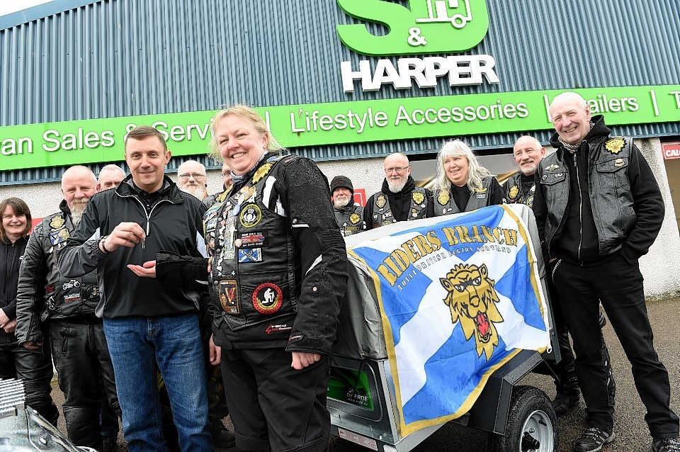 Stuart Harper, front left, hands over keys to Donna Lockyear, Royal British Legion Scotland Riders Branch