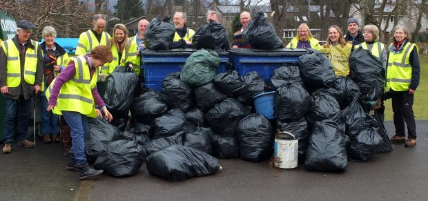 Volunteers from Monymusk pick up rubbish from the roadside