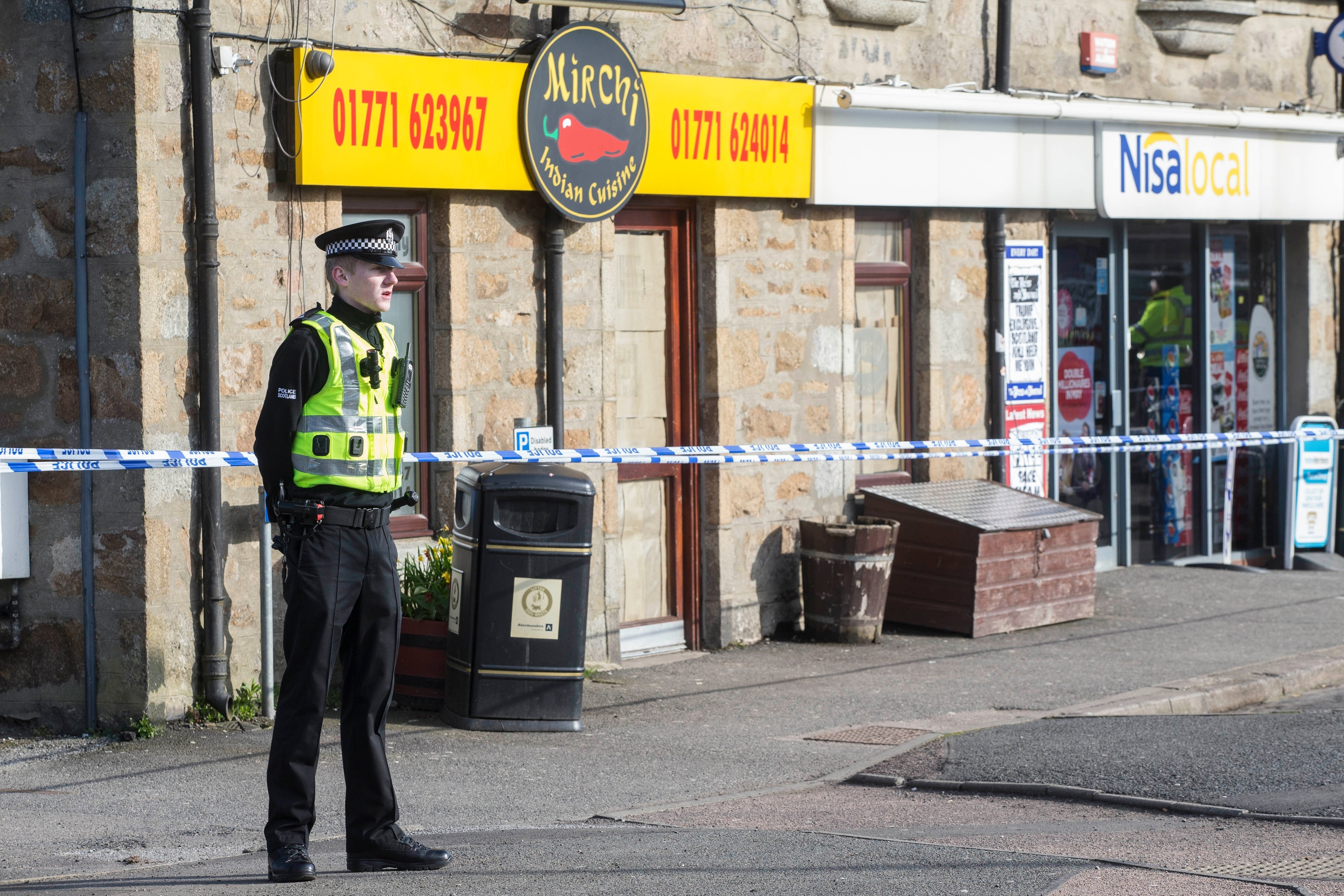 Police at the scene in Mintlaw following the death