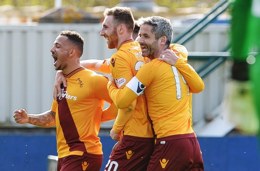 Motherwell's Lionel Ainsworth celebrates with his team-mates.