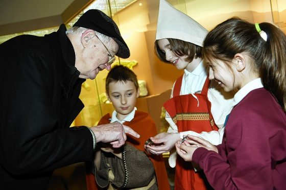 Visitor, John Forgie, is shown Viking artefacts by pupils Tyler Green, Carla Burnett and Mollie Grierson. Picture by Gordon Lennox