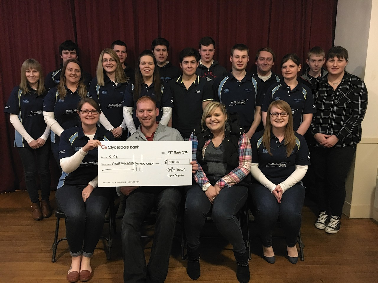 New Deer Young Farmers' Club members donating a cheque to Cardiac Risk in the Young
