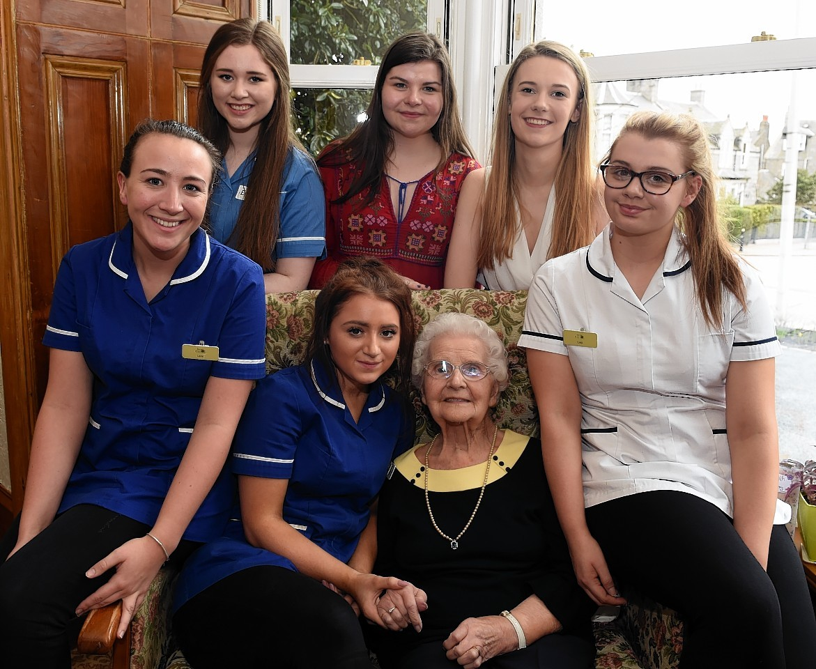 Nan Milton, celebrating her 100th birthday with family, friends and staff at Ashley House care home. Picture by Jim Irvine