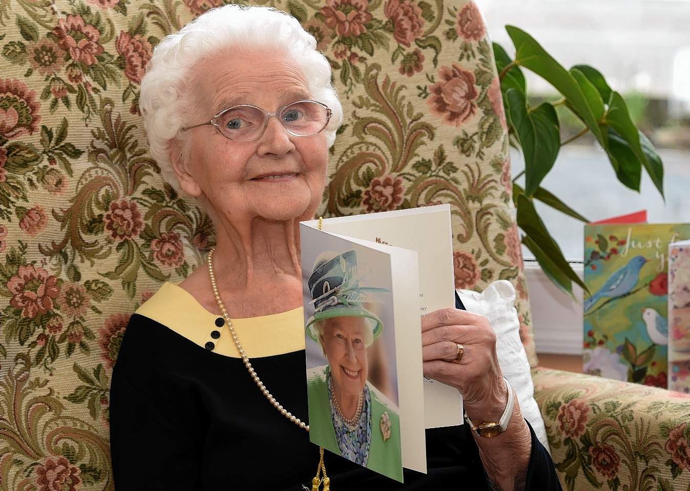 Nan Milton with her card from the Queen