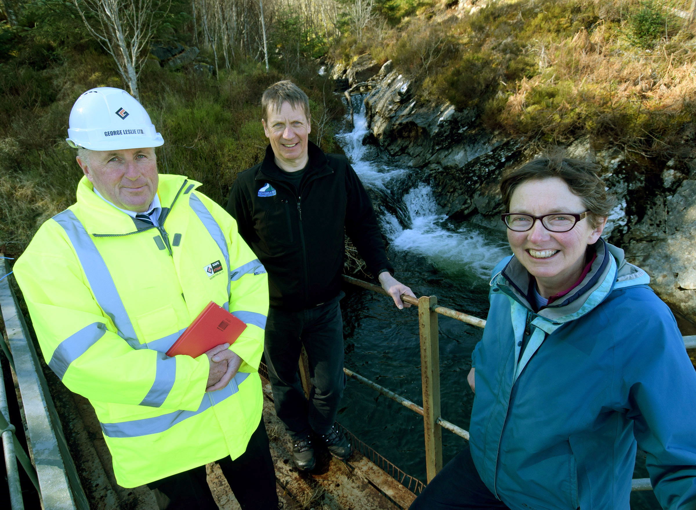 Charlie Gallagher (left), with Peter MacFarlane and Marian Austin at the burn which which will provide hydro power