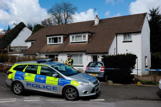 Police on the scene of the house where Xin Xin Liu was found