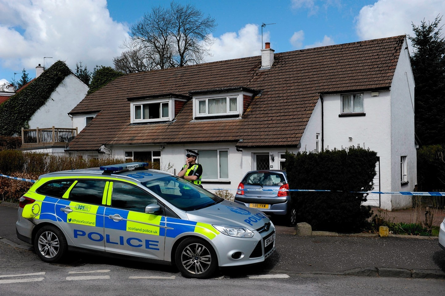 Police on the scene of the house where the attack took place