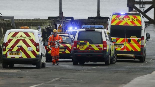 Police and ambulances on a pier near the site of the new Queensferry Crossing after a construction worker died.