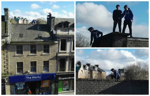 Children playing on rooftops in Inverness city centre. Pictures by Andy Adams