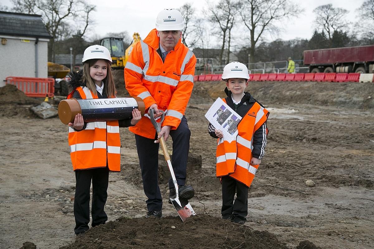 John McHardy, development officer at Robertson Eastern, breaks ground at Greenbrae Primary School.