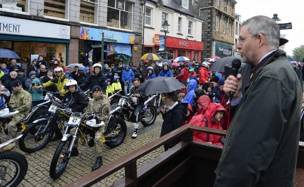 Councillor Thomas MacLennan welcomes riders at the start of a previous Scottish Six Days Trial in Fort William High Street