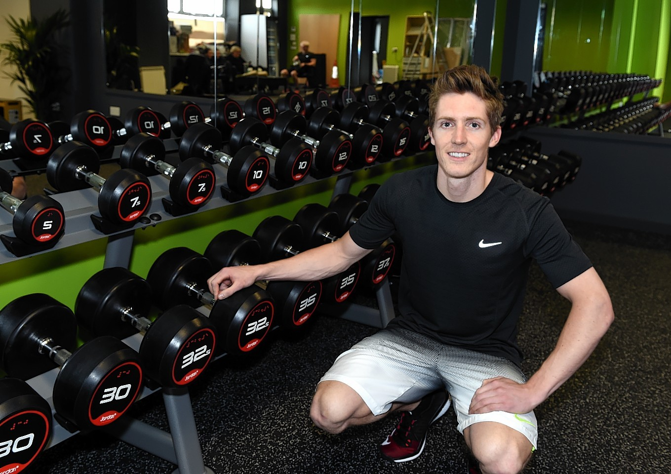 Ben Kilner by the weights section of The Unit