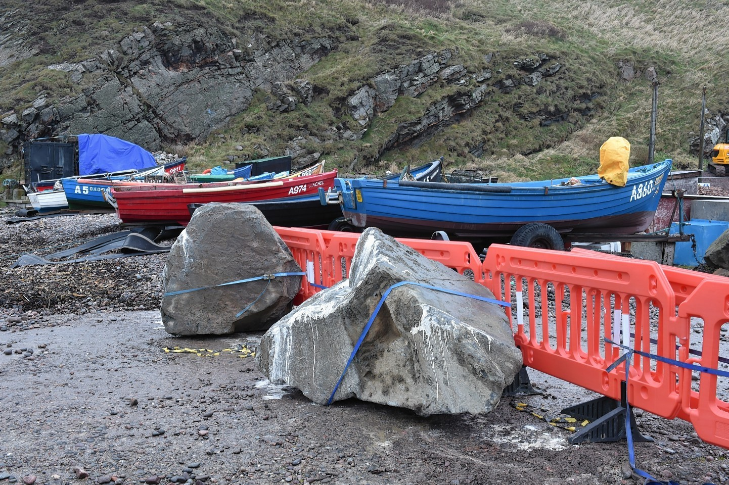 Large boulders and smaller stones arrive at Cove  Harbour to prevent access.