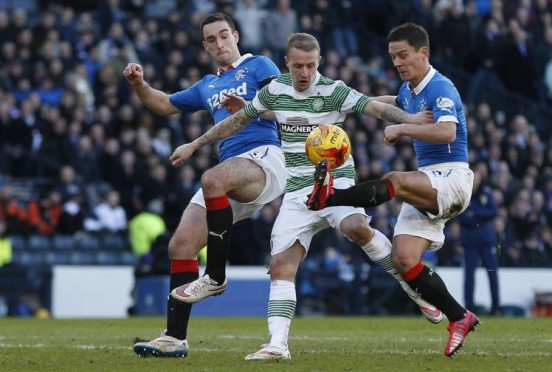 Celtic forward Leigh Griffiths goes up against Rangers duo Lee Wallace and Ian Black when the teams met last season