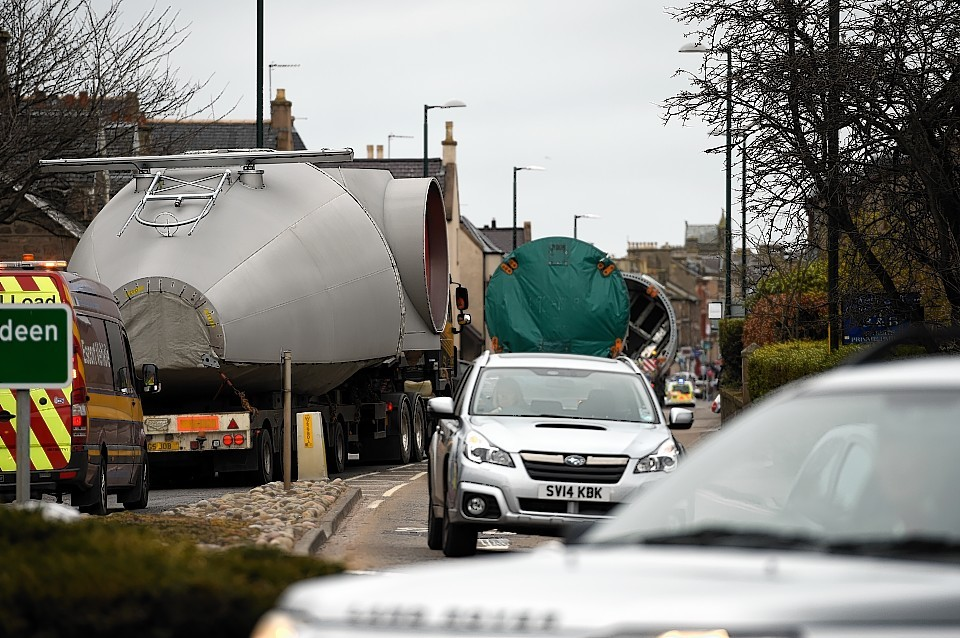 Oversize loads of wind turbine components as they are transported along the A96 through Elgin.